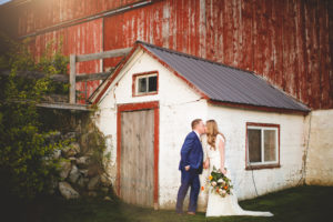 Bride Group kiss barn Cambium Farms wedding photography