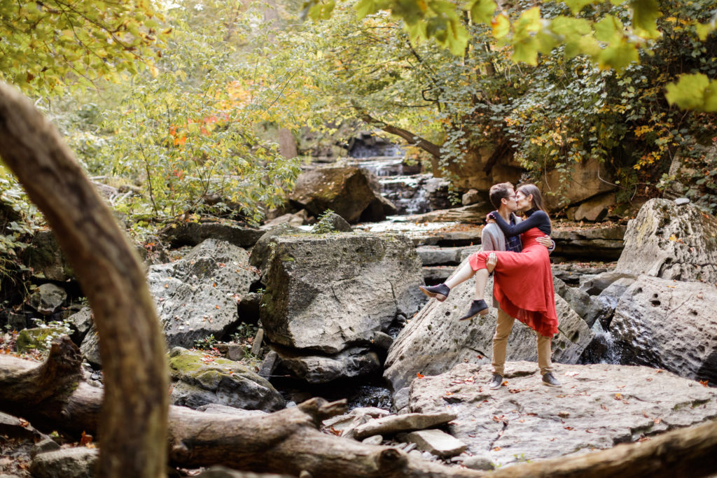 romantic kiss riverbed niagara bruce trail engagement session photographer