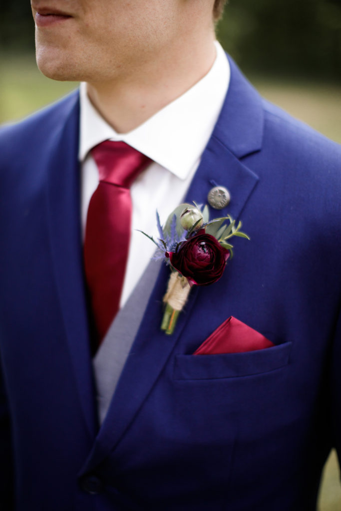 watering can flowers groom boutonniere burgundy balls falls wedding photography