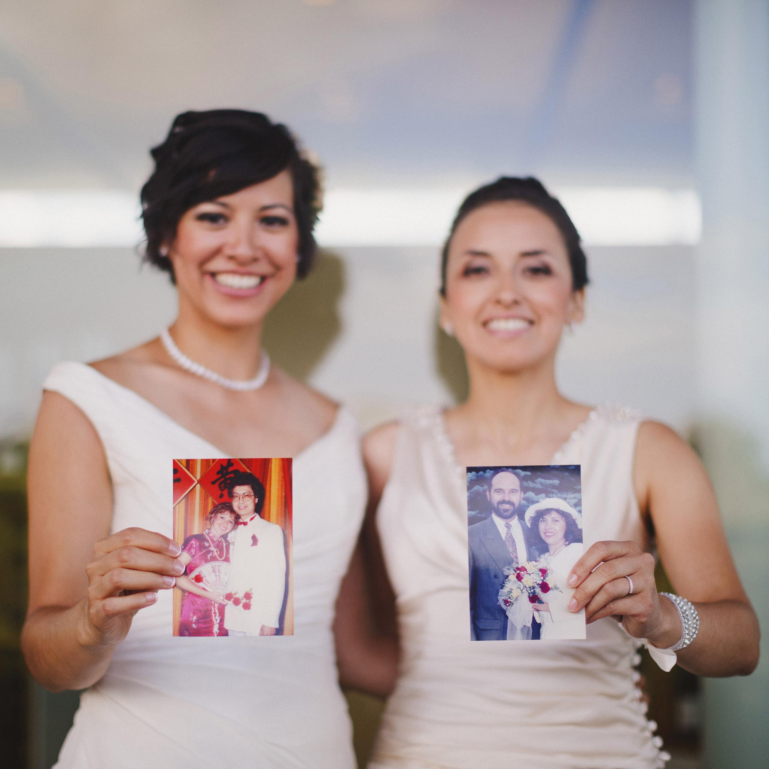 brides holding parents wedding photos niagara photographer