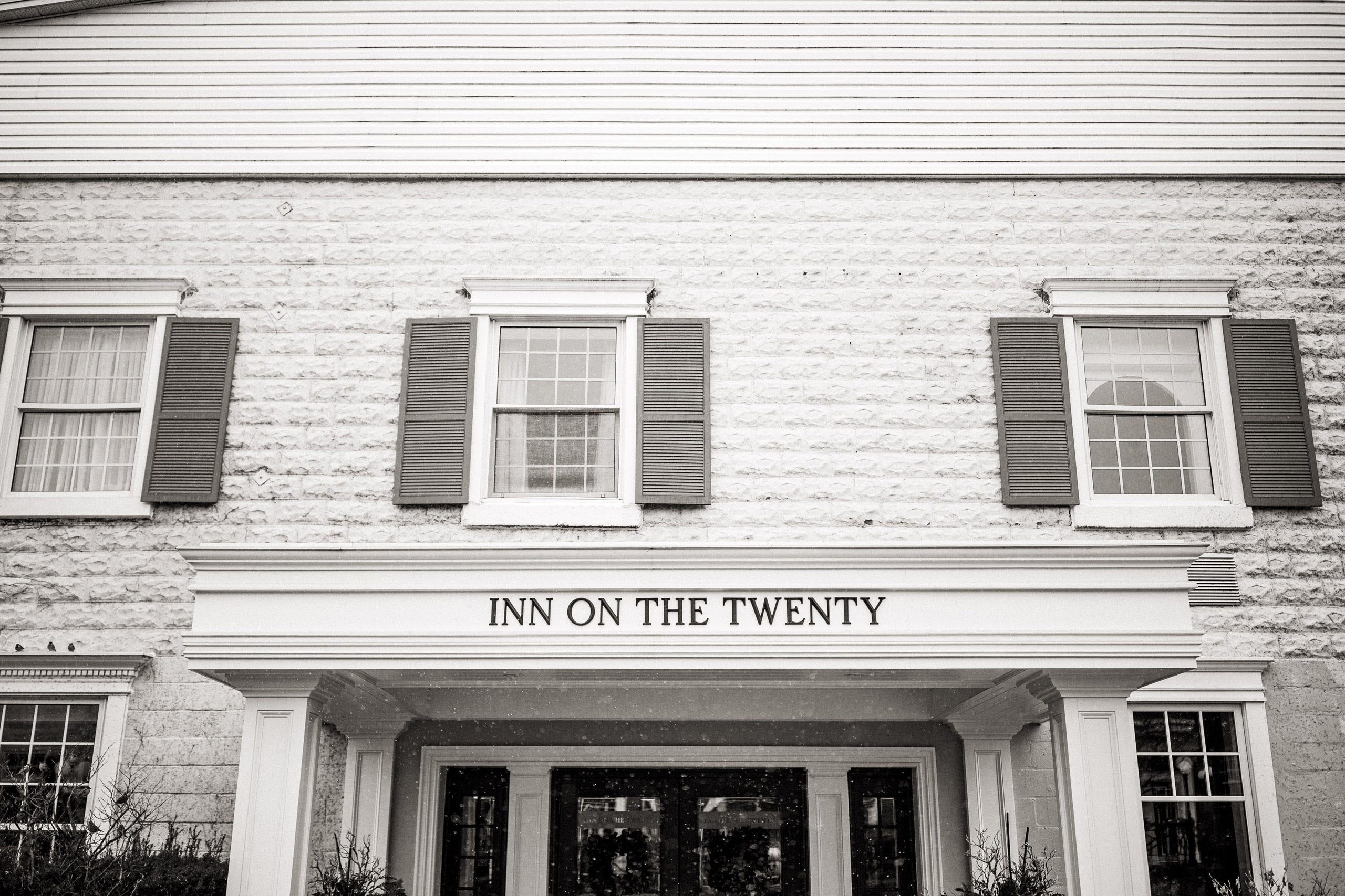 inn on the twenty winter wedding snow black and white photography