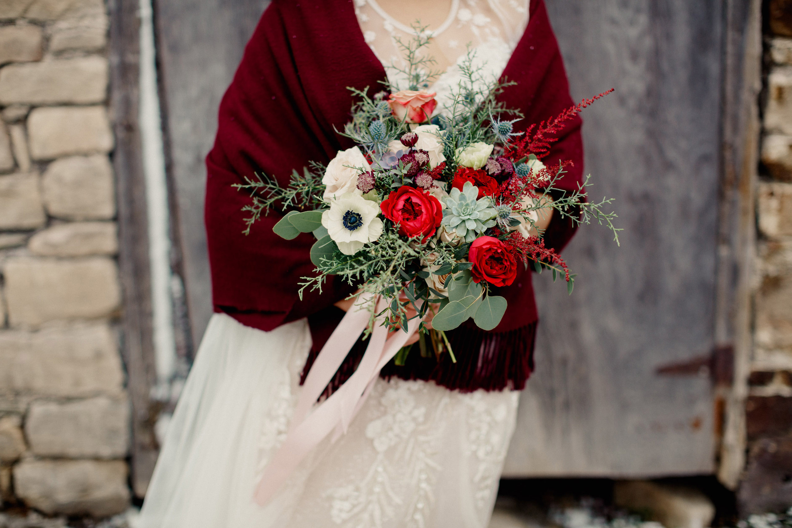 winter wedding bride bouquet flowers watering can niagara photographer