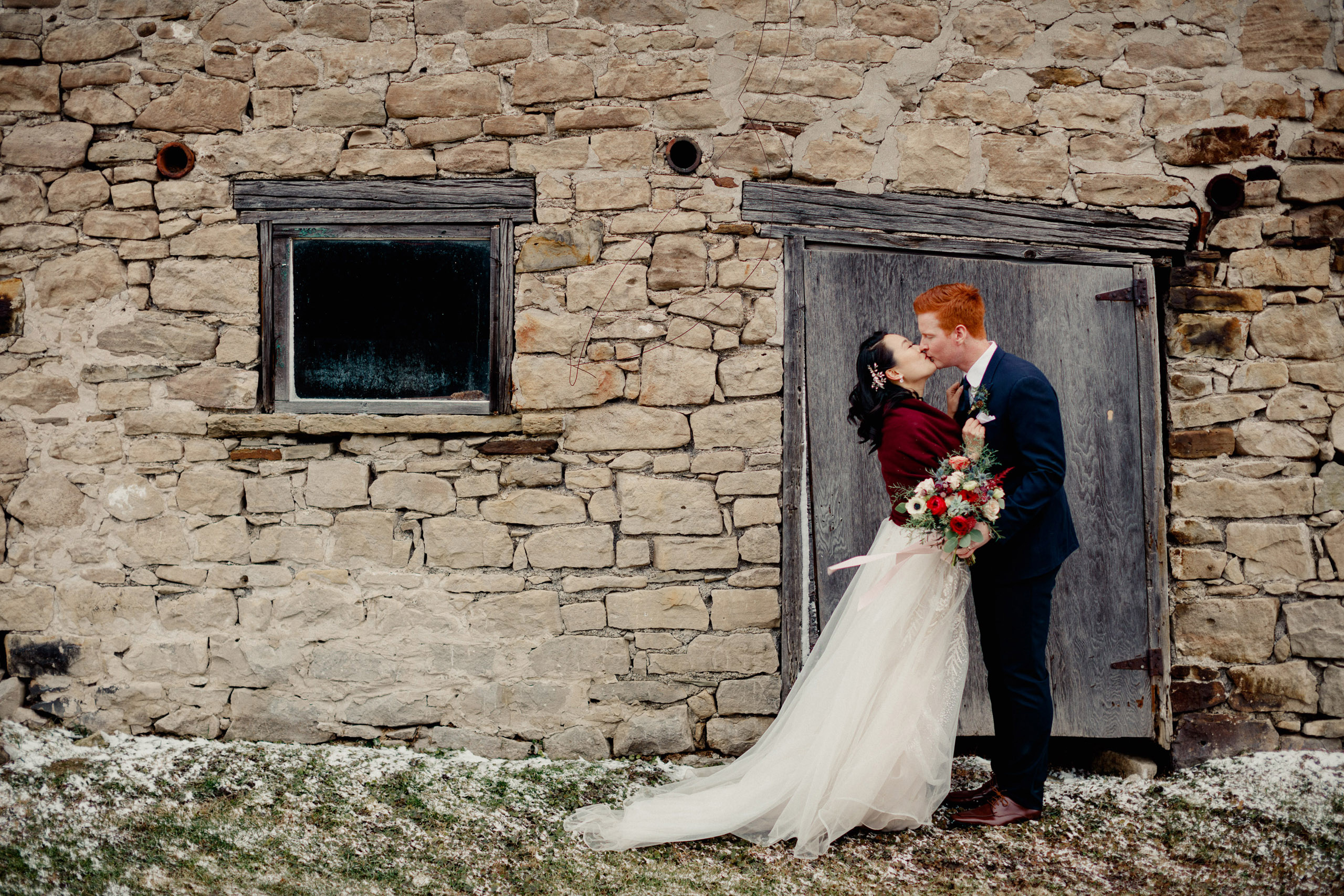 kiss stone barn cave spring winery wedding winter niagara photographer