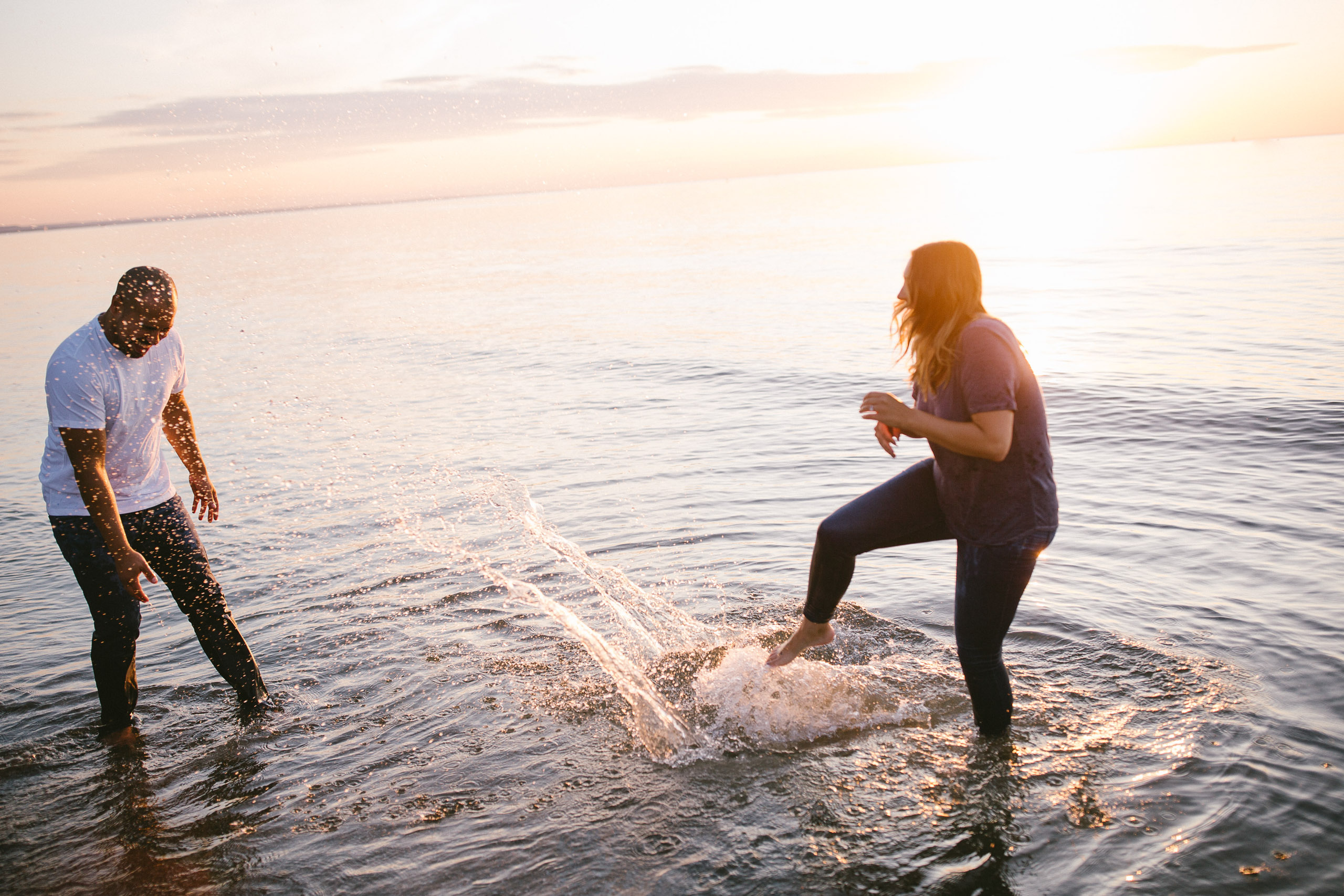 beach splash couple engagement shoot afterglow
