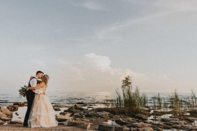 Even the ocean holds her breath for a moment like this. #aftergloweddings  . . #miniwedding #weddingday #beach #westcoastvibes #ocean #water #niagaraphotographer #niagaraweddings #kiss #clouds #sunset #hamiltonphotographer #niagara #southcoast #romance #justmarried #weddingday #kissme #marryme #thatview @canoncanada #weddingphotos #weddingphotography #diywedding #smallwedding #weddingstyle